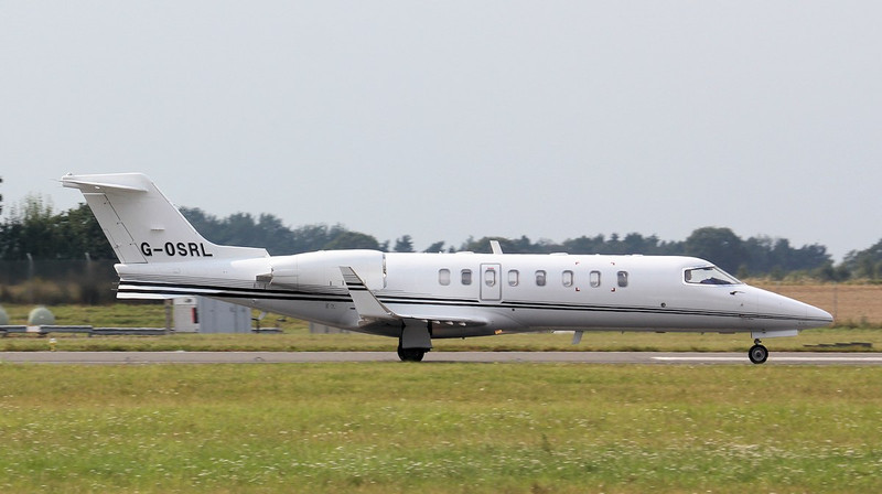 Learjet 45 G-OSRL departing.<br /> By Jim Calow.