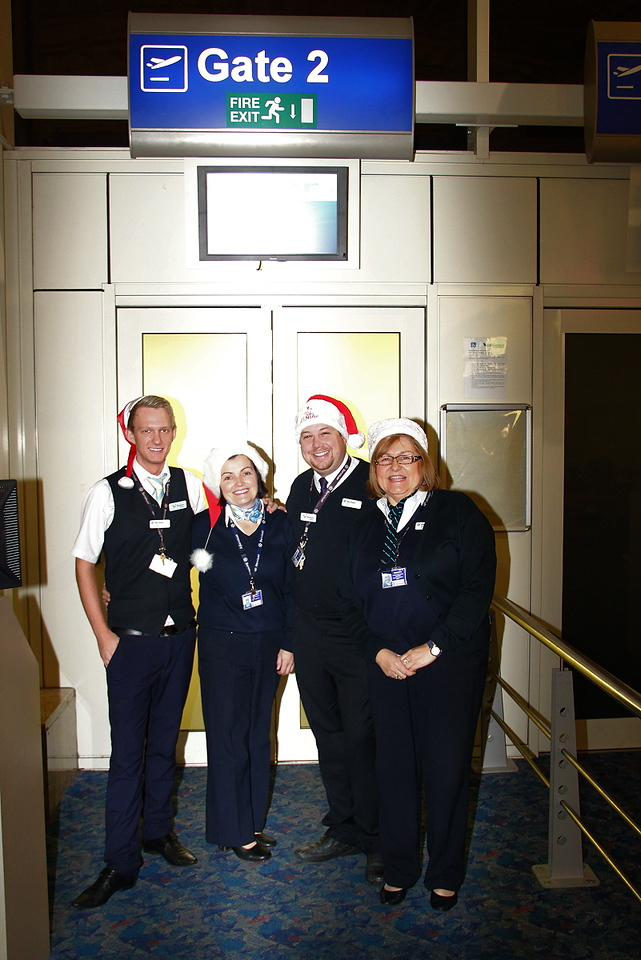 Boarding gate staff for the Santa flight<br /> By Clive Featherstone (courtesy of FODSA)