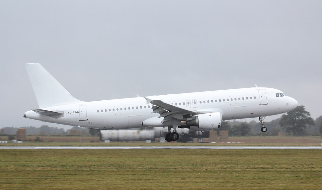 SmartLynx A320 YL-LCA operating for Thomas Cook.<br /> By Jim Calow.