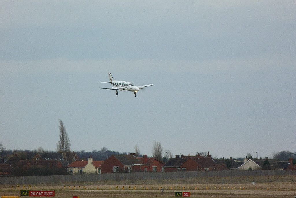 Final approach for Piper PA-31-350 Navajo Chieftain G-VIPU. in strong winds<br /> By Clive Featherstone.