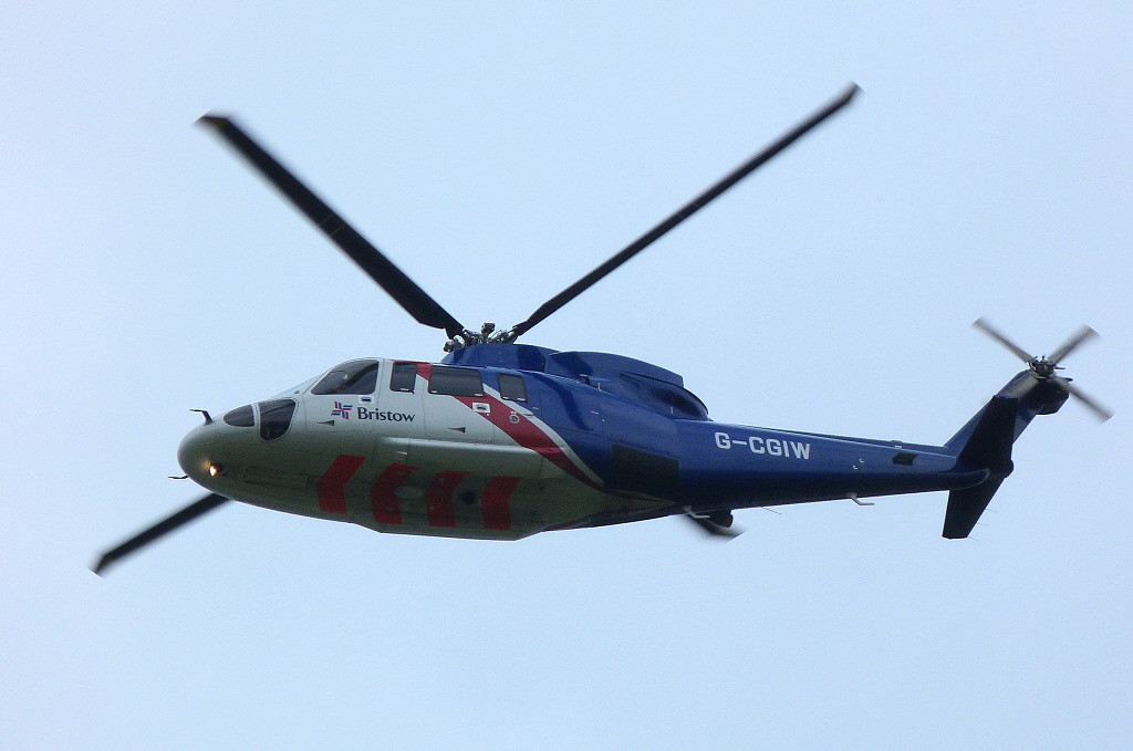 Bristow Helicopters, Sikorsky S-76C-2 Spirit G-CGIW makes a training approach before departing for Humberside..<br /> By Clive Featherstone.