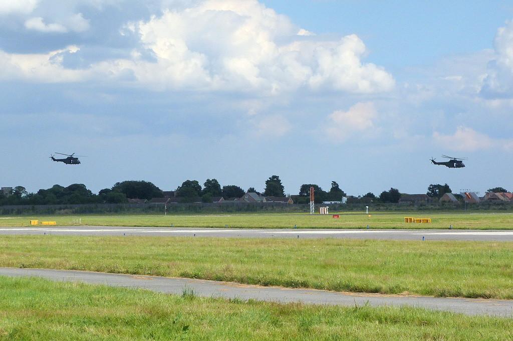 RAF Puma HC1's XW220 & XW210 make a low pass along rnwy 20.<br /> By Clive Featherstone.
