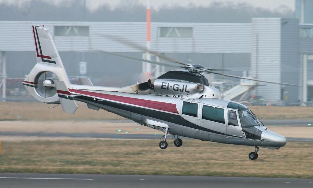 Aerospatiale SA365N Dauphin III, EI-GJL departing for the Emerald Isle.<br /> By Jim Calow.
