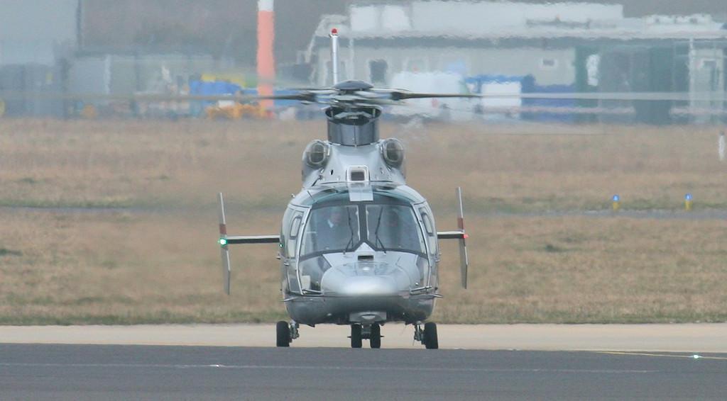 Aerospatiale SA365N Dauphin III, EI-GJL enters the runway at 'Charlie'<br /> By Jim Calow.