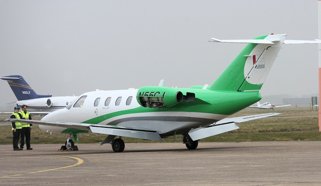 Sporting the corporate colours of German software company 'Think-Cell', Cessna 525 CitationJet CJ1, N55CJ.<br /> By Jim Calow.