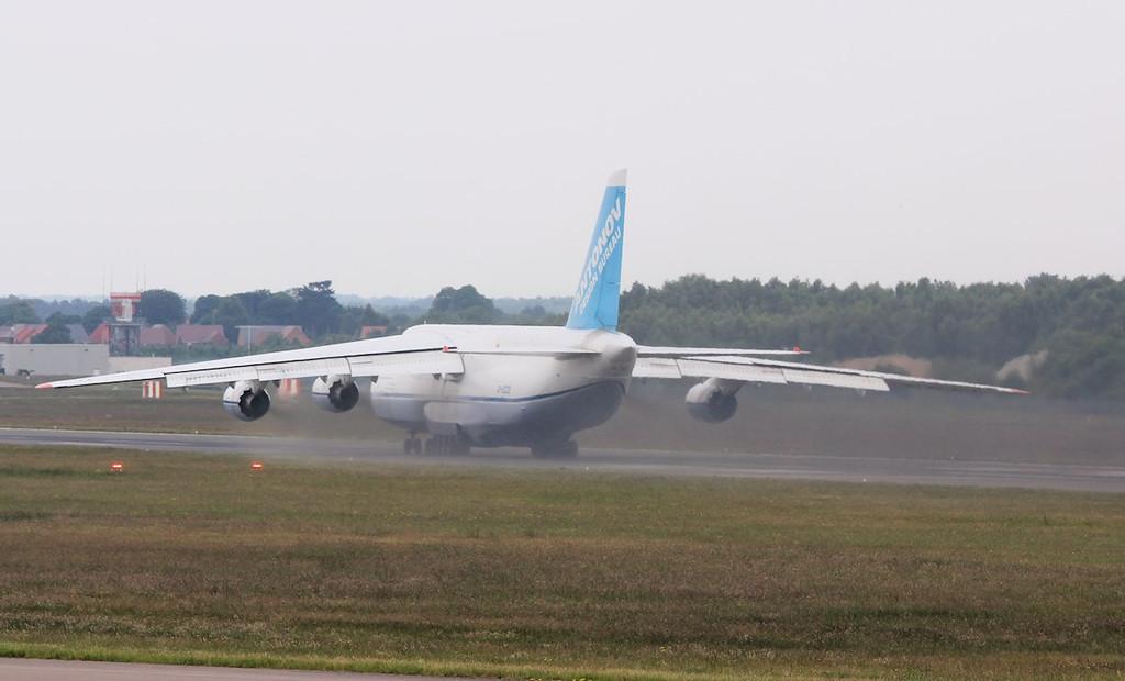 Leaving it's customary smokey haze.........Antonov Design Bureau An-124-100 UR-82009.<br /> By Correne Calow.
