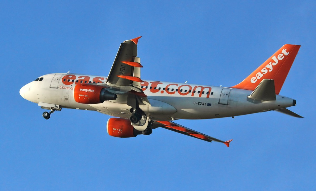 EasyJet A319, G-EZAT.<br /> By Jim Calow.