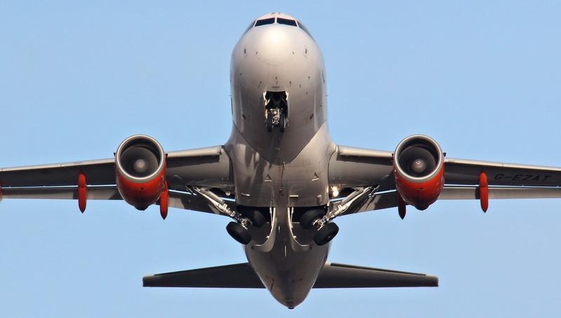 EasyJet A319, G-EZAT.<br /> By Jim Calow.