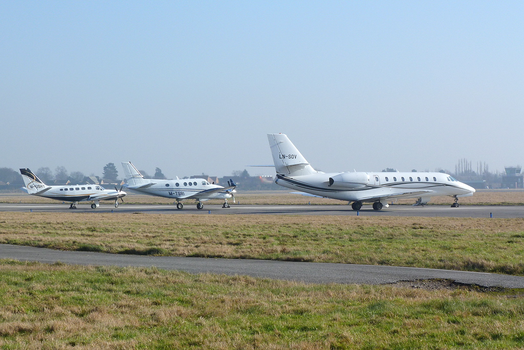 L to R - Cessna 441 Conquest II, M-USHY, Beech C90GTi King Air, M-TSRI<br /> Cessna 680 Citation Sovereign (cn 680-0183), LN-SOV<br /> By Clive Featherstone.