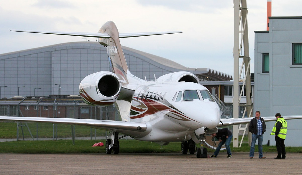 Cessna 750 Citation X M-ARCH is readied on the Cessna apron before departing around 18:00.<br /> By Jim Calow.