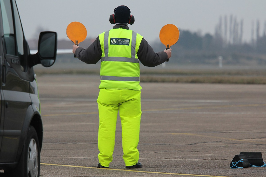 Weston Aviation Marshaller directing M-PRVT.<br /> By Correne Calow.