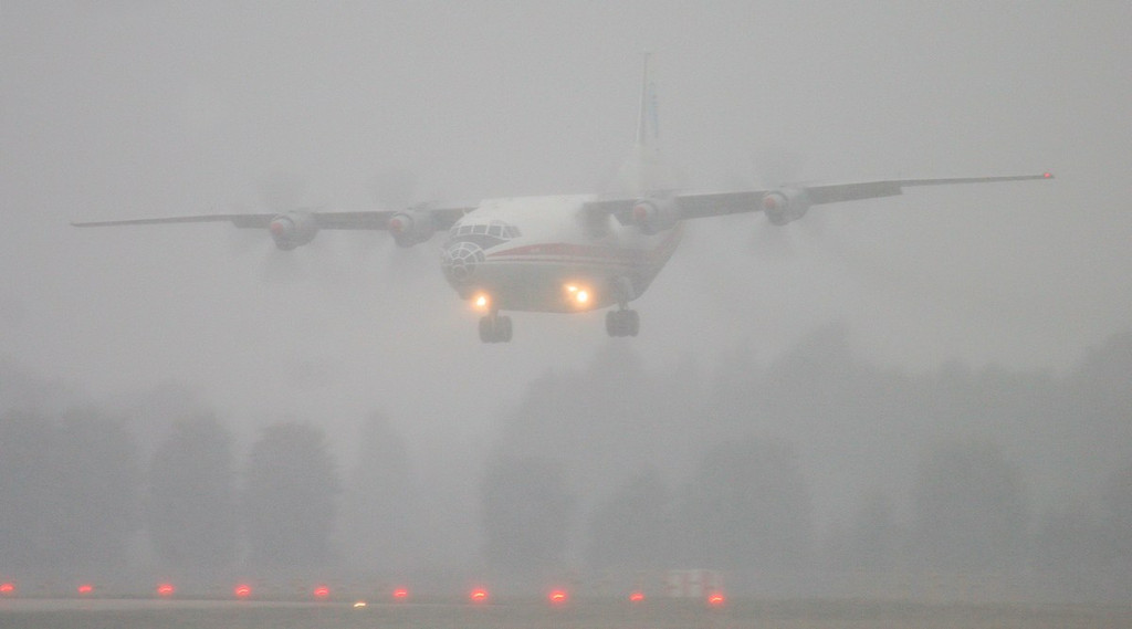 The snow started falling heavier just in time for the arrival of the, Ukraine Alliance, Antonov An-12BK, UR-CAJ.<br /> By Jim Calow.