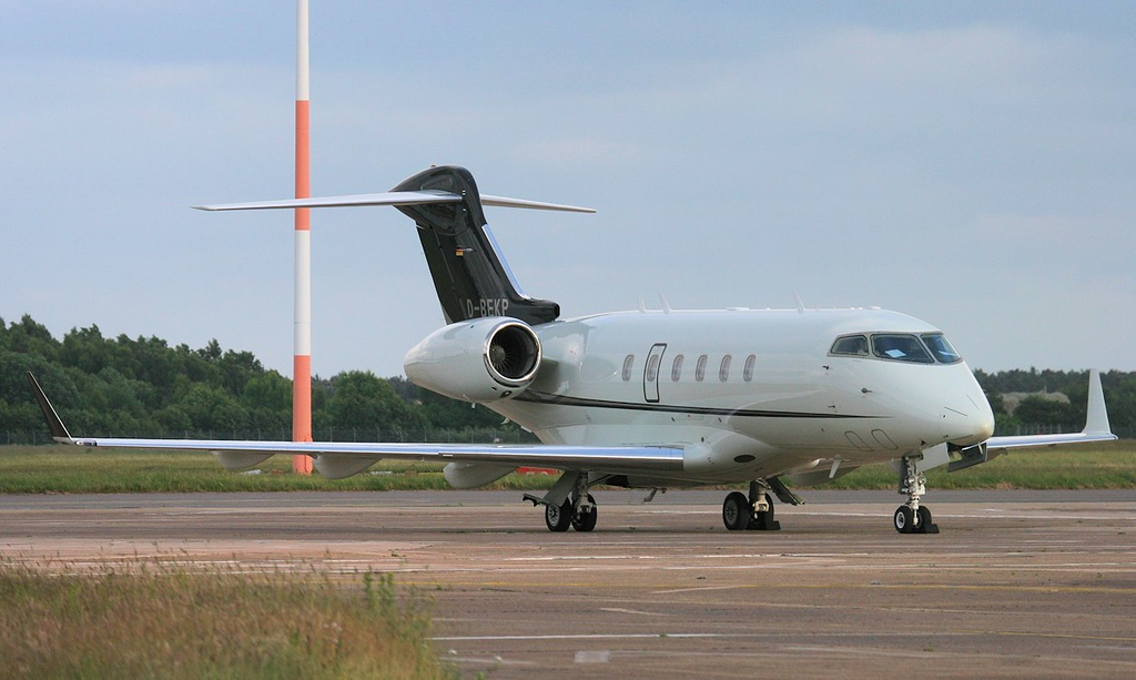 Windrose Air BD-100-1A10 Challenger 300,.......... parked on stand 16 after arriving at 17:25.<br /> By Jim Calow.
