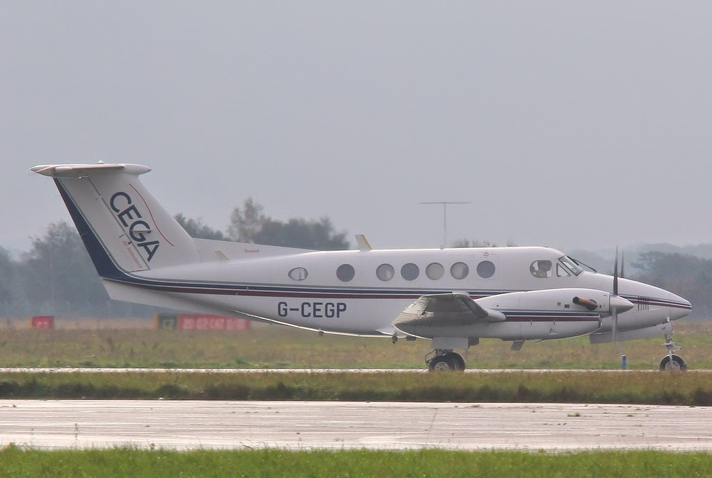 Cega Air Ambulance, Beech 200 Super King Air, G-CEGP arrives in the rain at 0915<br /> By Correne Calow.