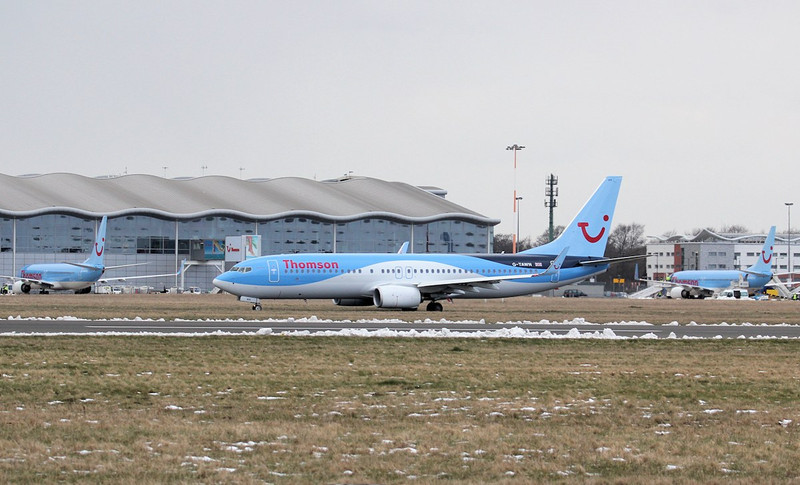 Flanked by G-TAWB & G-FDZW, Thomson Airways newest 737-800, G-TAWN taxis for departure.<br /> By Jim Calow.