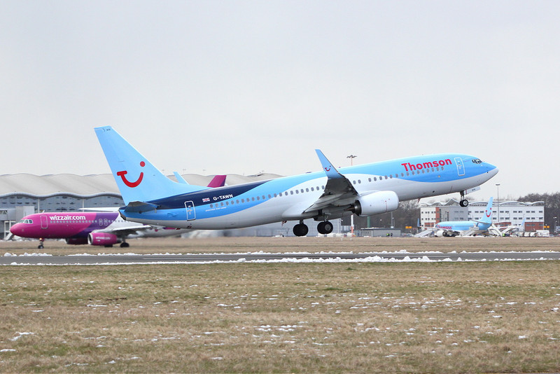 Thomson Airways 737-800 G-TAWN gets airborne as HA-LPL taxis for departure.<br /> By Clive Featherstone.