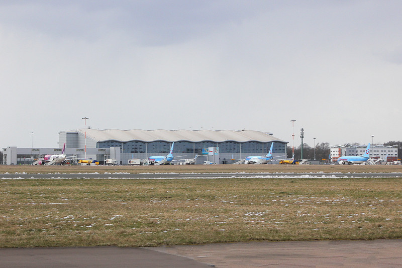 Looking more like an airport again........Wizz Air & three Thomson aircraft await their next load of passengers.<br /> By Clive Featherstone.