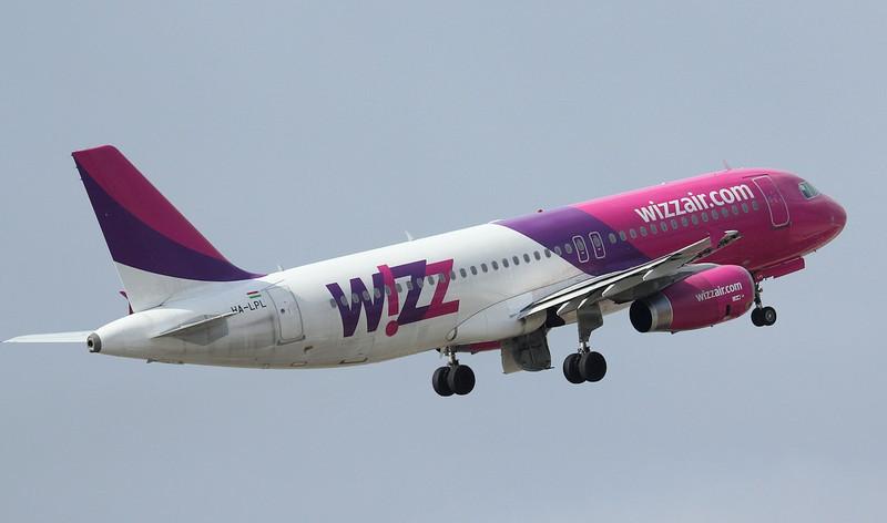 Wizz Air A320 HA-LPL departs.<br /> By Jim Calow.