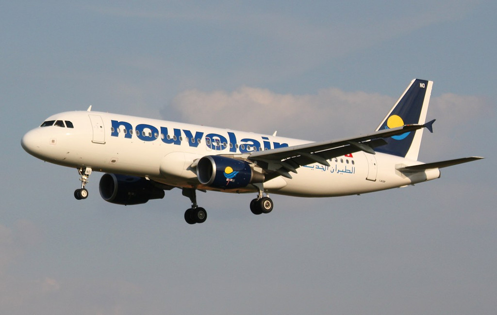 Nouvelair A320, TS-INO on finals for rnwy 02.<br /> By Correne Calow.