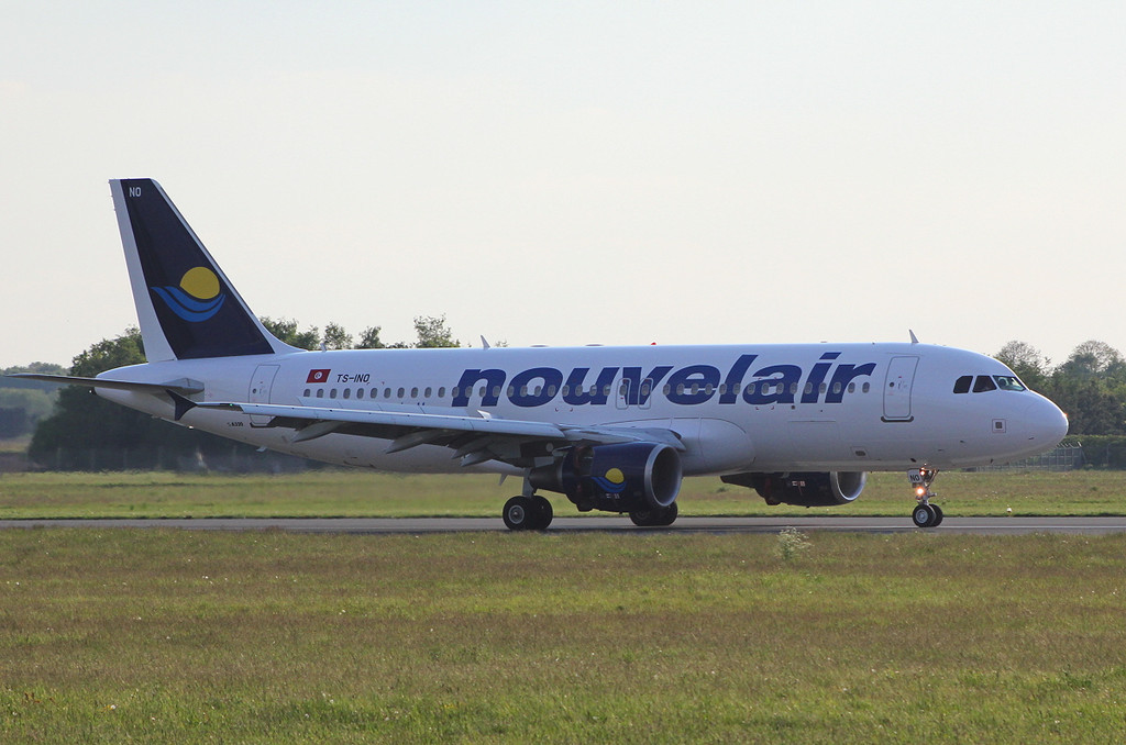 Nouvelair A320, TS-INO.<br /> By Clive Featherstone.