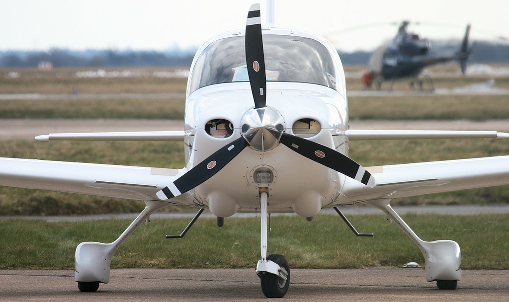 Cirrus SR-20 GTS, G-DOLI. Unusual to see other than Beech or Cessna on the maintenance apron.<br /> By Jim Calow.