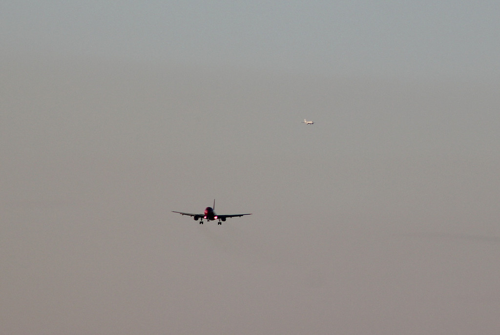 Wizz Air A320 HA-LWC on the ILS with Thomas Cook A320 YL-LCL turning onto the ILS in the distance.<br /> By Clive Featherstone.