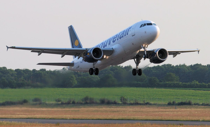 Nouvelair A320 TS-INH departs to Glasgow.<br /> By Jim Calow.