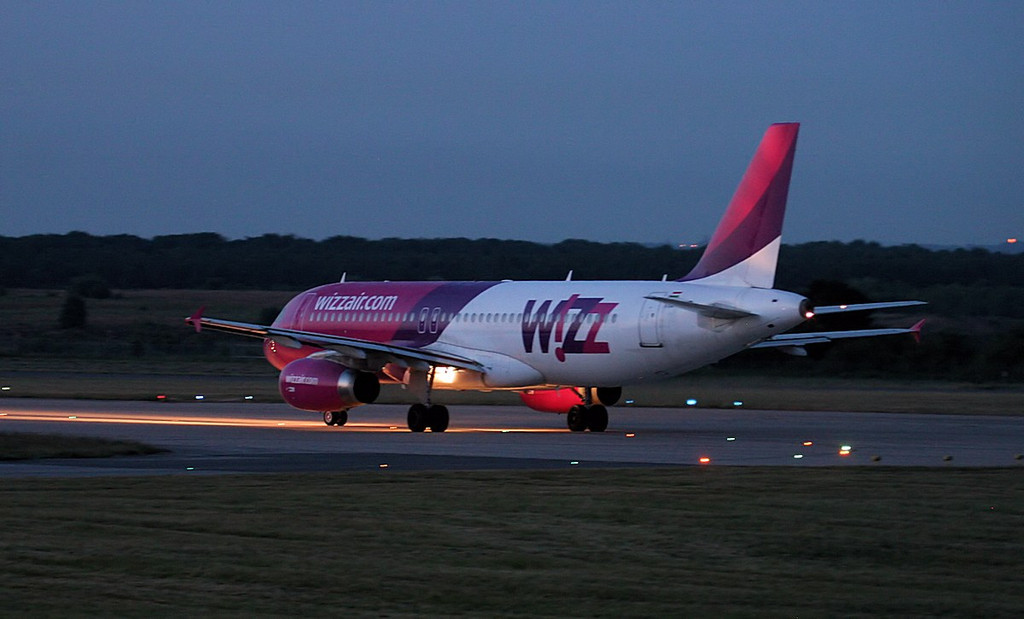 Wizz Air A320, HA-LWB lined up for departure at 22:00.<br /> By Jim Calow.