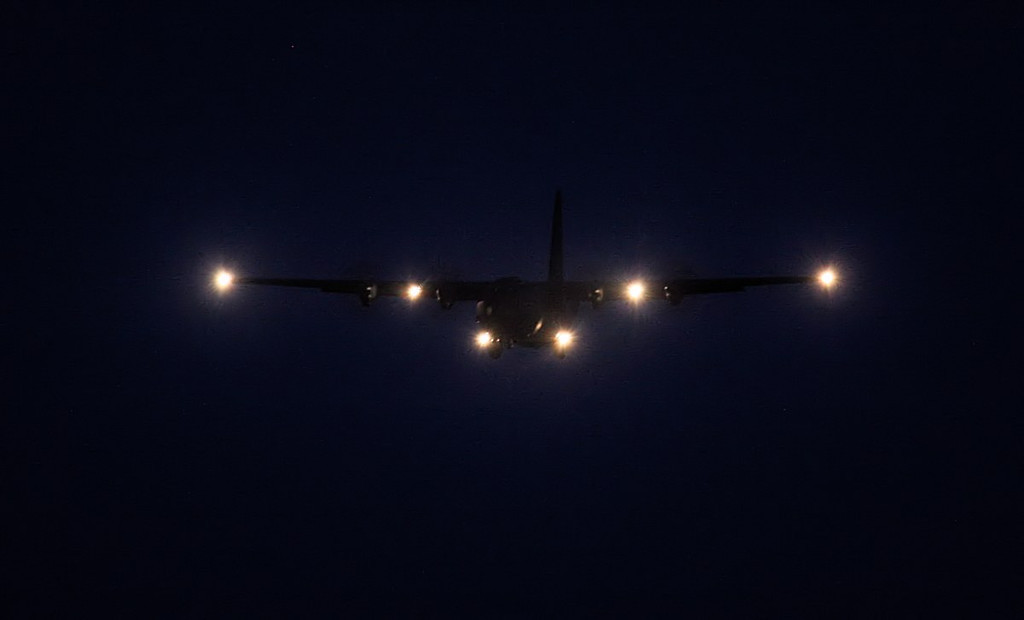 Lighting the way ahead.........C-130J Hercules C5, ZH889 makes a missed approach at 22:23.<br /> By Jim Calow.