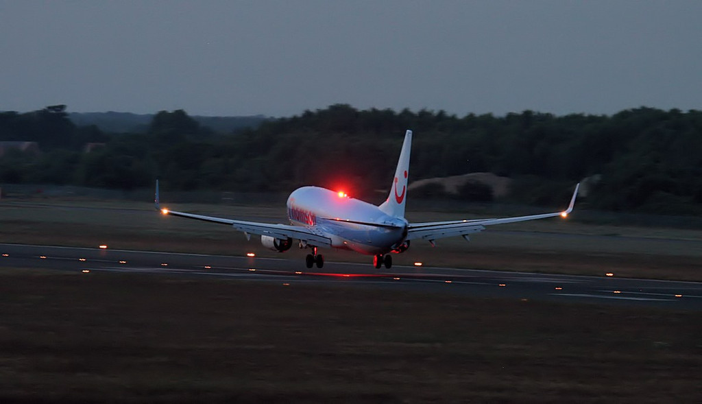 Thomson Airways 737-800, G-TAWA about to touch down at 21:55<br /> By Jim Calow.
