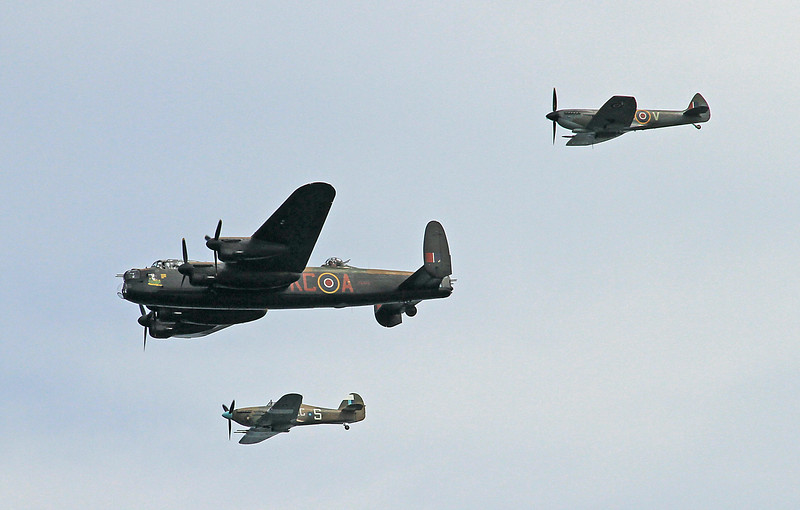 The Hurricane,Lancaster Bomber and Spitfire doing the (Battle of Britain) flypass.