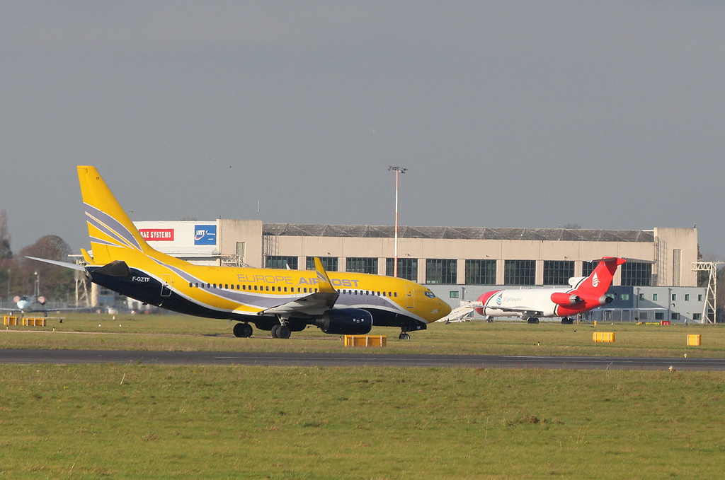 B737 F-GZTF provides a colourful contrast to B722 G-OSRA.<br /> By Clive Featherstone.
