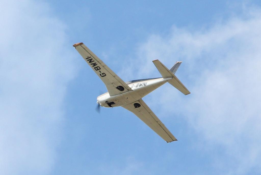 Piper PA-24-180 Comanche, G-BWNI.<br /> By Clive Featherstone.