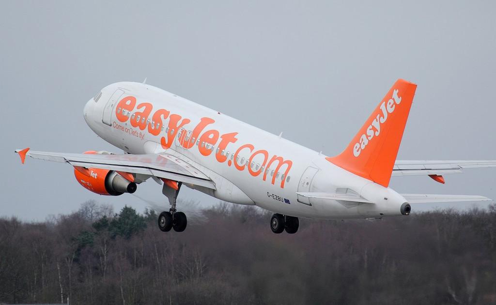 EasyJet A319, G-EZBU departs empty.<br /> By Jim Calow.