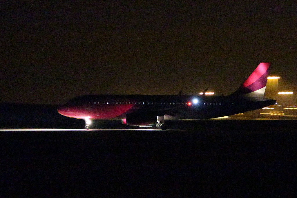 Wizz Air A320 HA-LWT. 25600ISO, 1/30sec, F5.6.<br /> By Clive Featherstone.