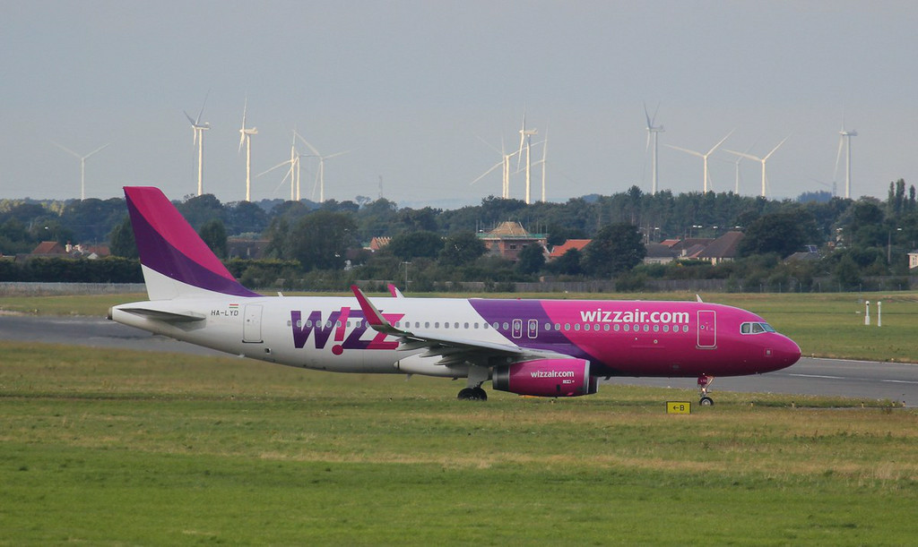 "Something I've never seen before.........Wizz Air A320 HA-LYD taxis for departure from the intersection of ""Bravo"" & runway 02.<br /> By Jim Calow."