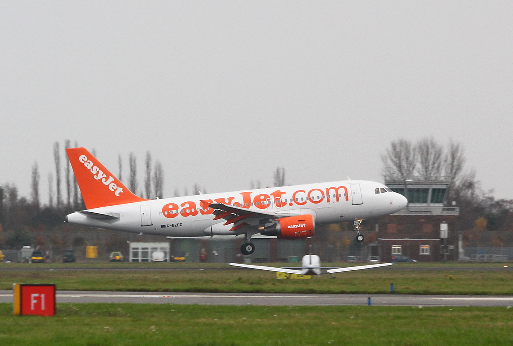 easyJet A319, G-EZDZ in the training circuit<br /> By Clive Featherstone.