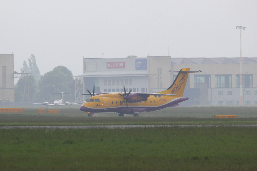 At 13:45 the Welcome Air Dornier Do-328-110 OE-GBB taxied for departure.<br /> By Clive Featherstone.