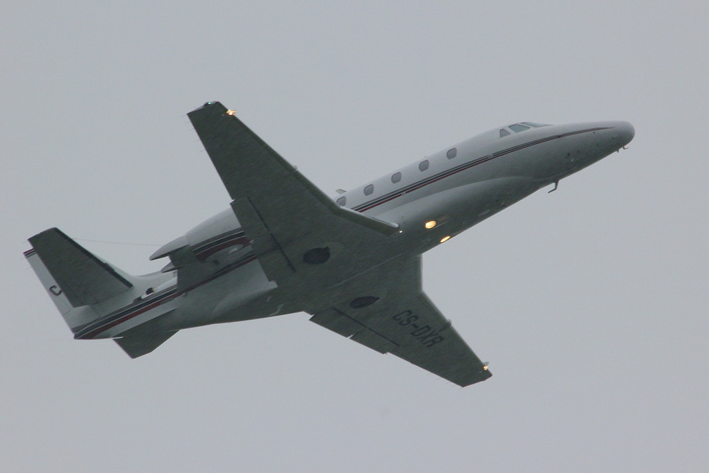 NetJets Cessna 560XL Citation XLS, CS-DXR climbs into the murk.<br /> By Clive Featherstone.