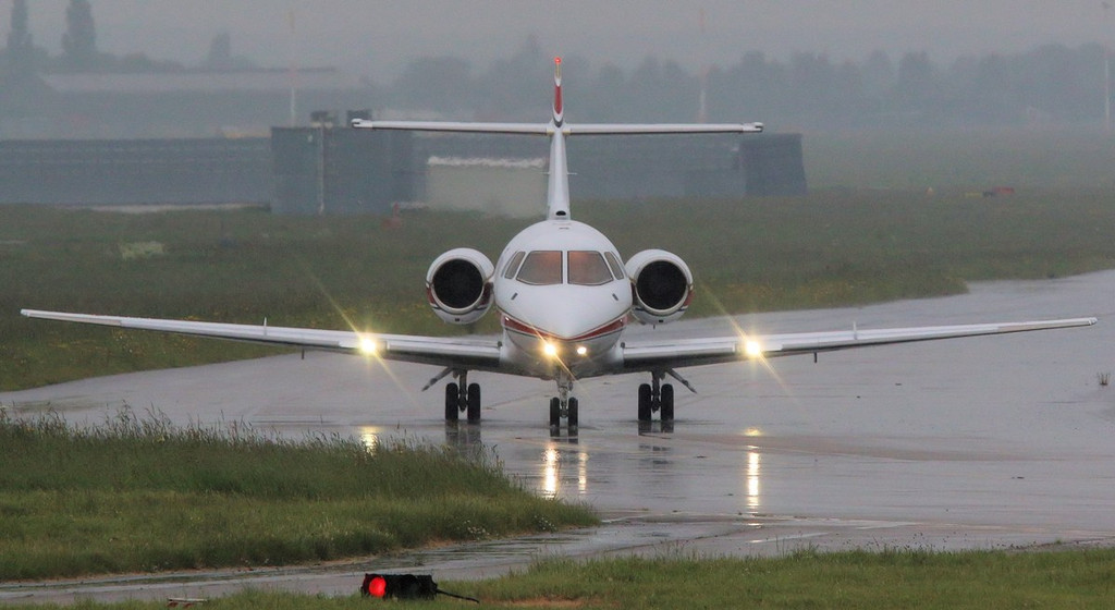 In the pouring rain, Executive Jet Charter, BAe 125-800 G-VIPI taxis for departure.<br /> By Correne Calow.