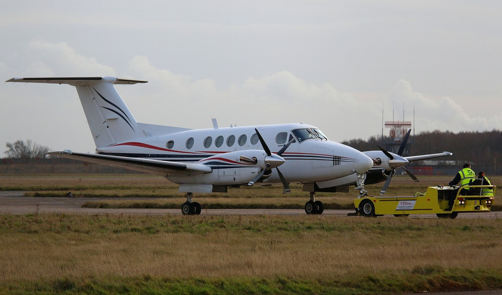 Beech 200 Super King Air G-BVMA being towed to the maintenance apron.<br /> By Correne Calow.