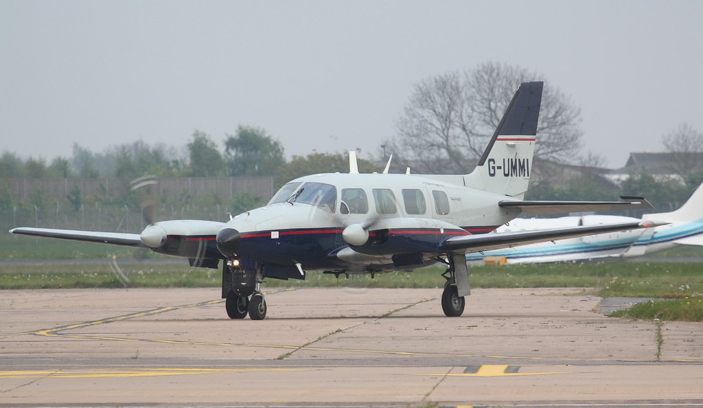 2Excel Aviation, Piper PA-31-310 Navajo C, G-UMMI taxis for departure.<br /> By Jim Calow.