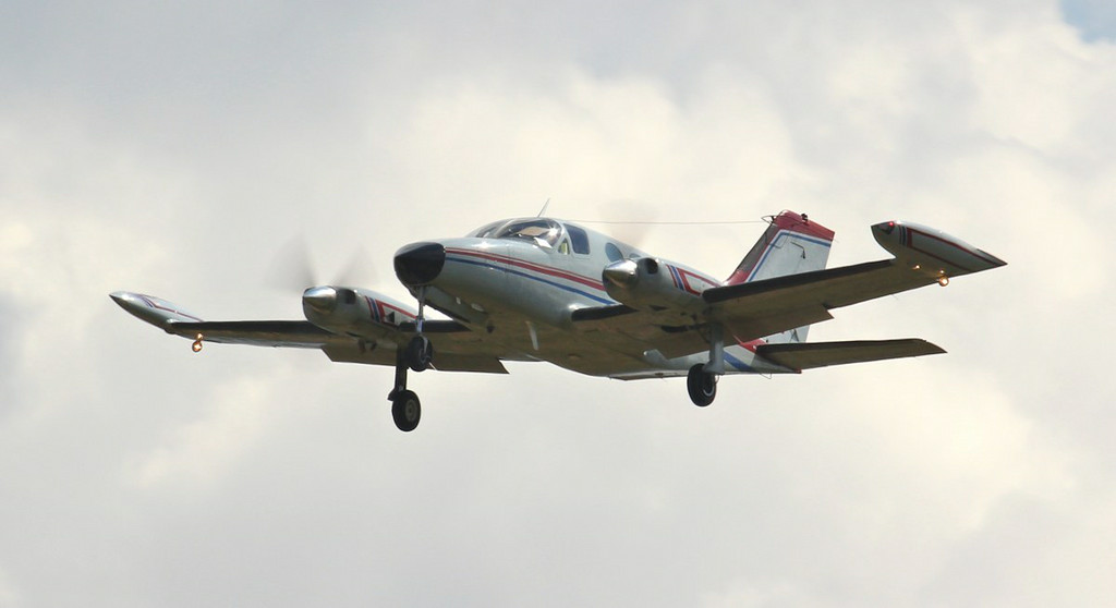 Making a missed approach this afternoon is Cessna 414 Chancellor II, N44NE.<br /> By Jim Calow.
