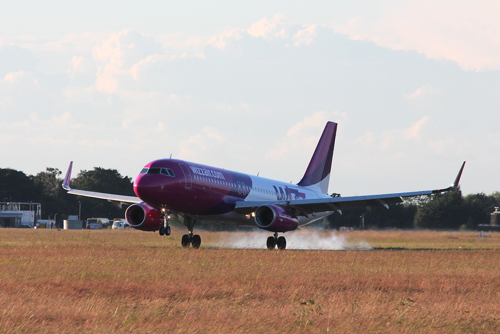 Wizz Air A320, HA-LYD<br /> By Clive Featherstone.