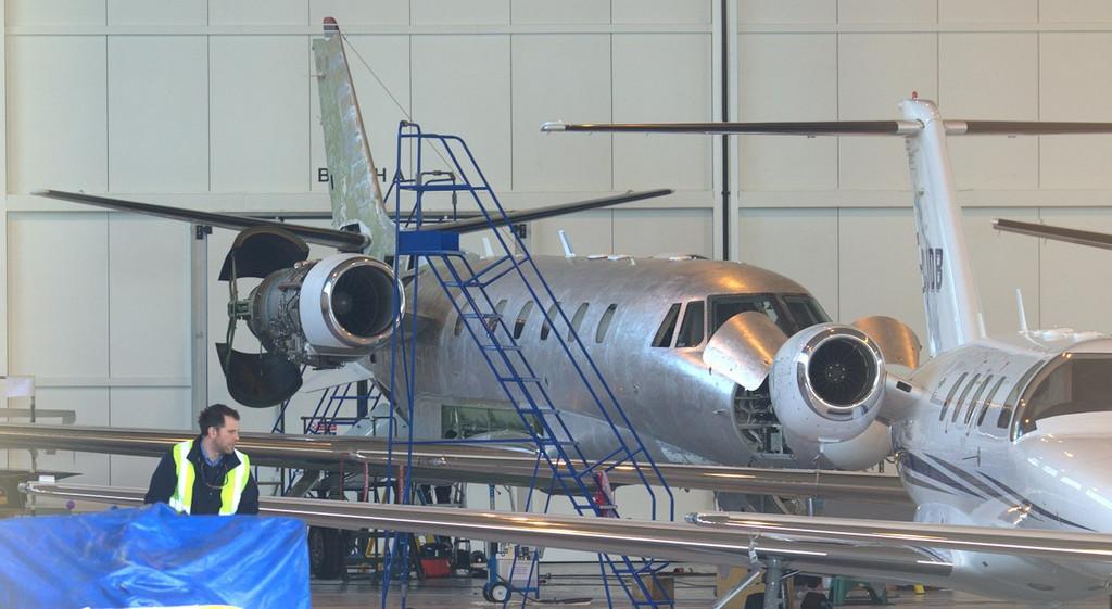 At the back of the hangar........NetJets Cessna 560XL Citation XLS CS-DXK.<br /> By Jim Calow.