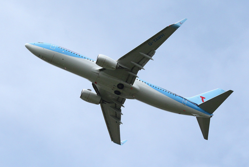 Thomson Airways 737-800 G-TAWH, climbs into the circuit for another approach.<br /> By Clive Featherstone.
