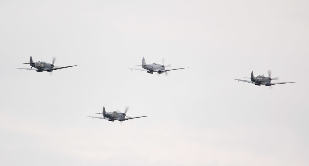 L-R Spitfire Mk XVIe TD248 (G-OXVI), Mk IXT PV202 (G-TRIX), Mk FR XVIIIe SM845 (G-BUOS), Mk IXT SM520 (G-ILDA).<br /> By Jim Calow.