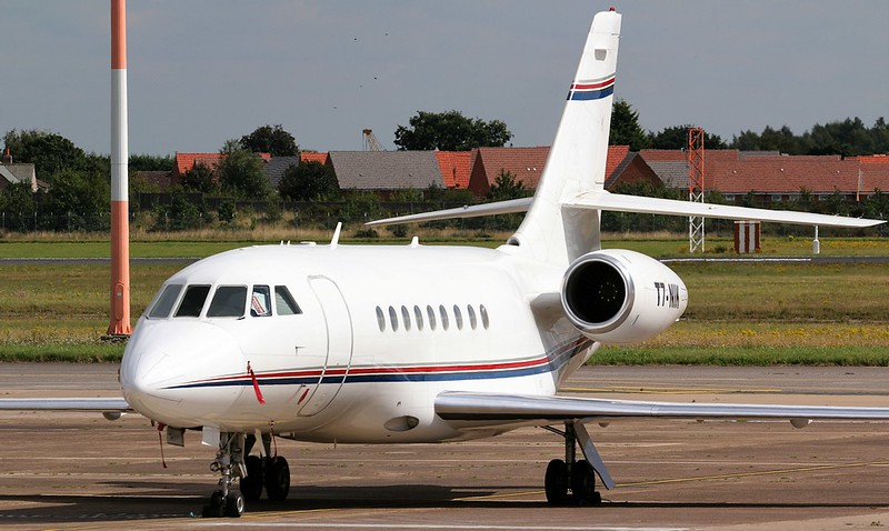 This Falcon 2000, T7-NIK, arrived late morning.<br /> By Jim Calow.