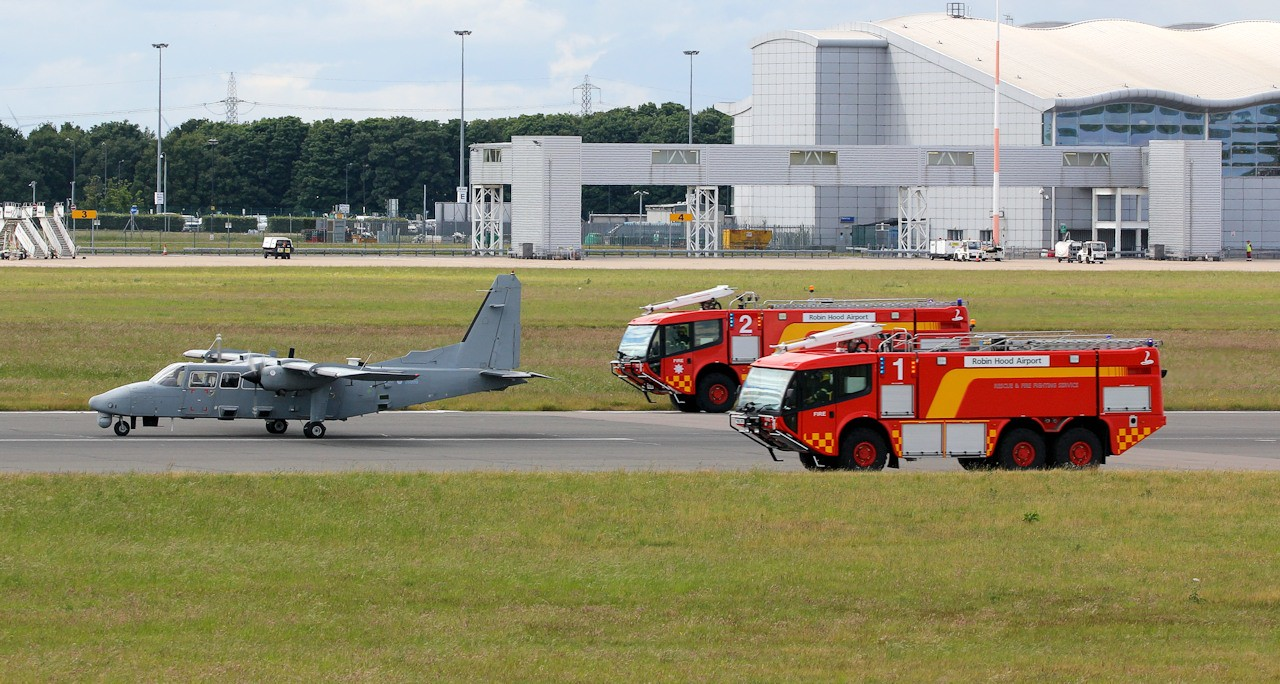 The fire tenders were quickly on the scene as the Islander came to a halt on the runway.<br /> By Jim Calow.
