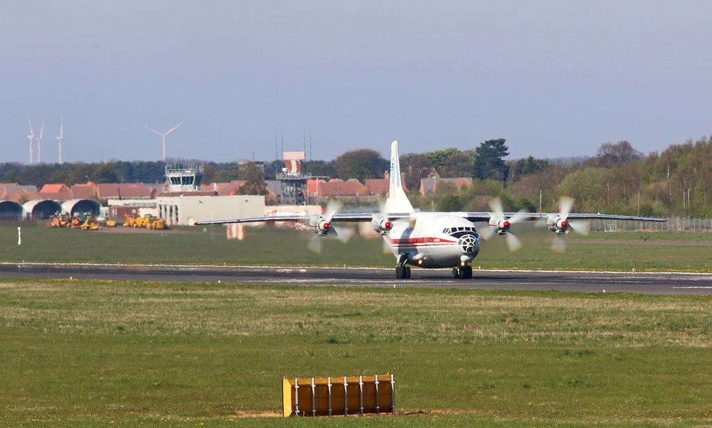Ukraine Air Alliance (UAA) Antonov An-12BK, UR-CAH shimmers in the sunshine on arrival<br /> By Correne Calow.
